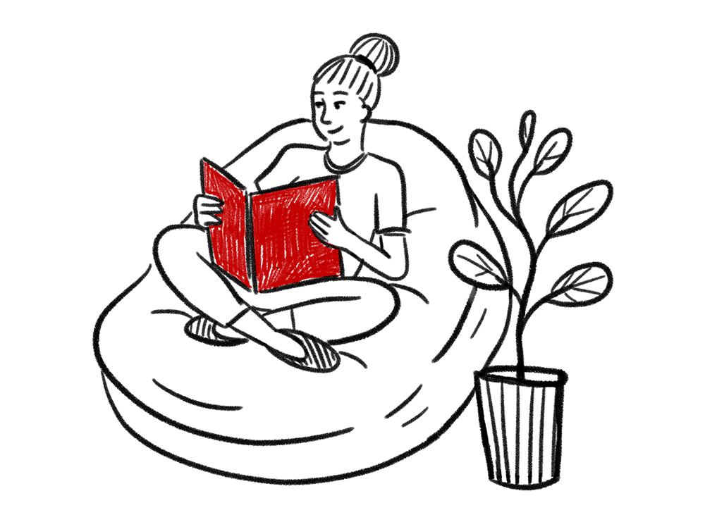Girl reading red book on large bean bag
